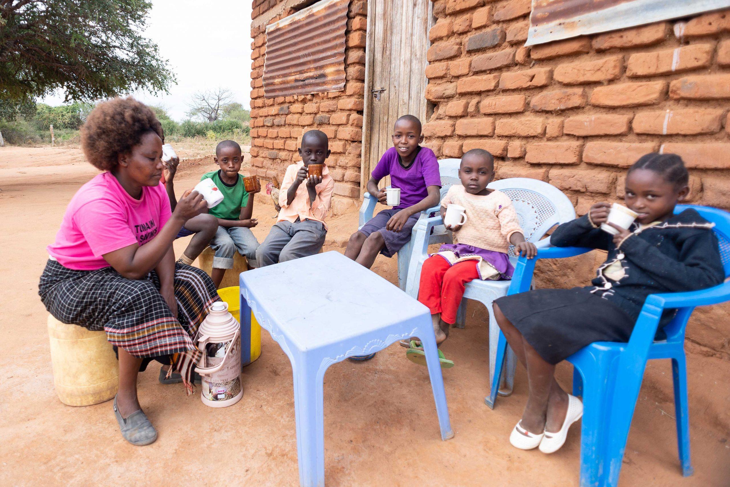 Scholastica eats with her children