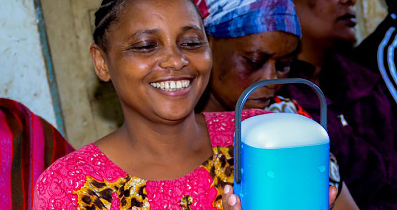 A woman with a solar light in Tanzania