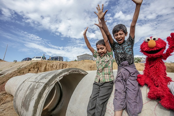 Rohingya children playing with elmo from sesame street