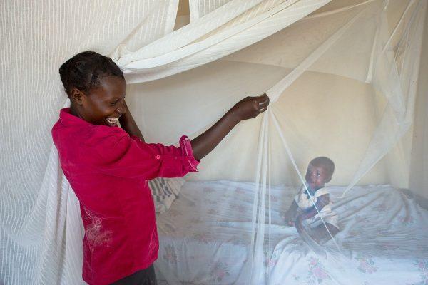women holding a bednet