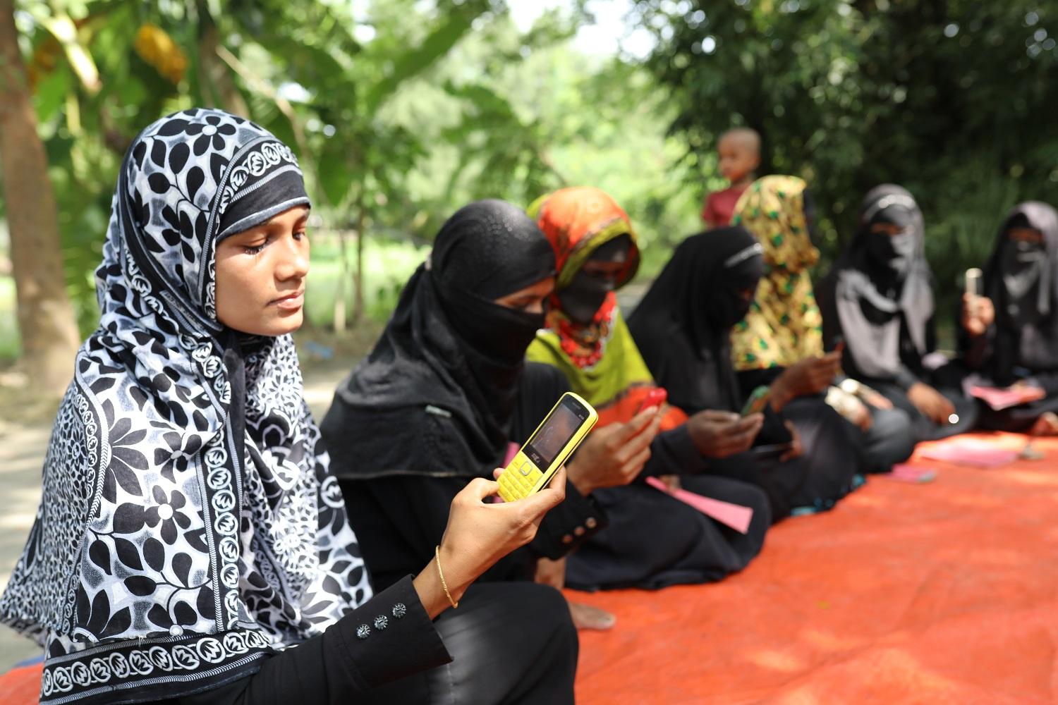 women using a mobile money app