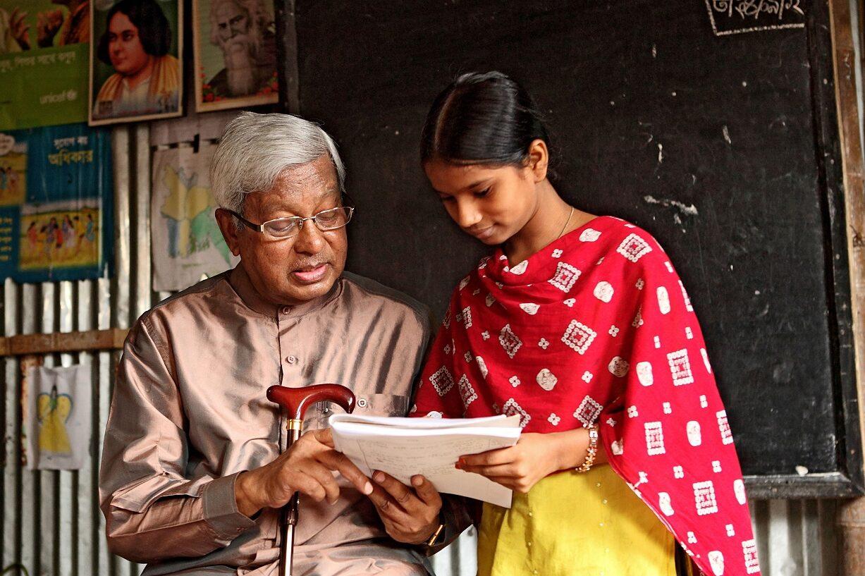 Sir Fazle with a girl reading