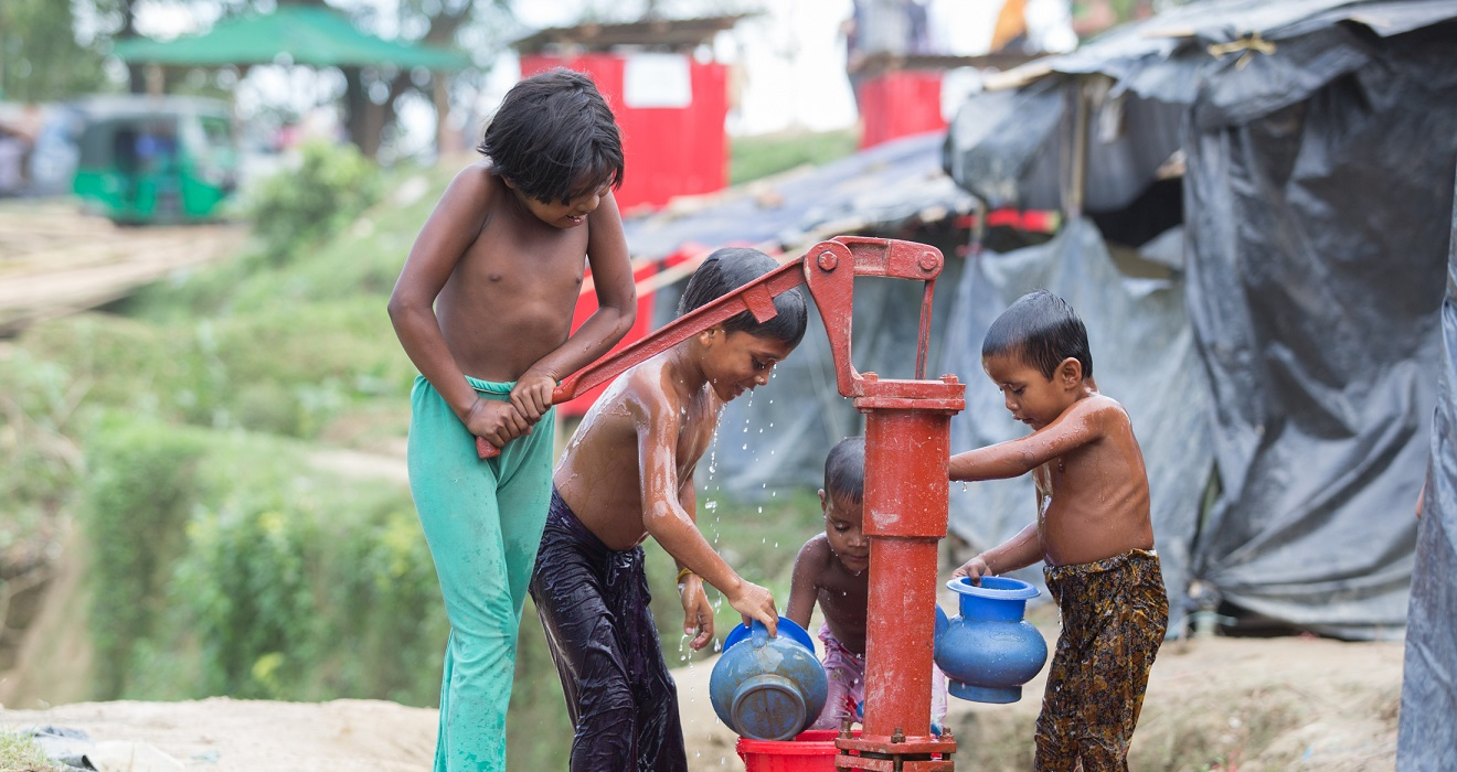 kids washing at a water station