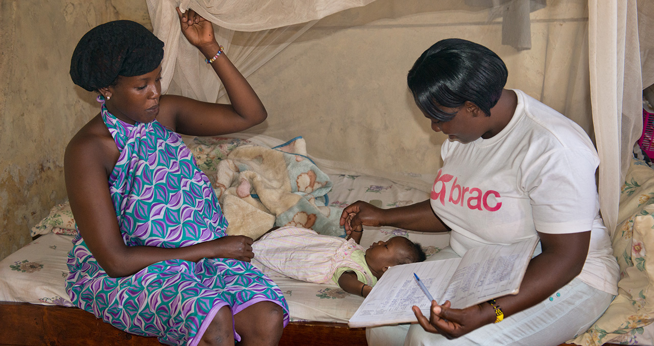 A community health worker cares for a mother and child in Uganda. Photo by Alison Wright.