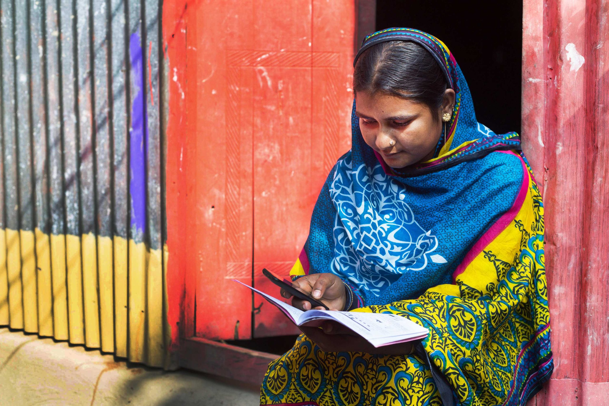 Woman using bKash, a mobile money service