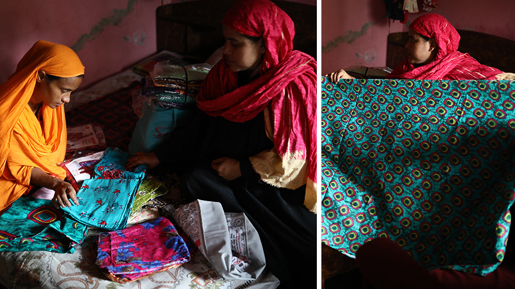 Nurjahan, a participant of BRAC's Ultra-Poor Graduation Program in Bangladesh, sells fabric at her small business.