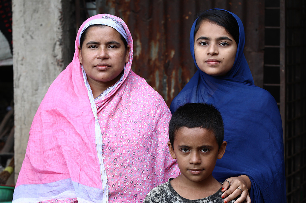 Nurjahan, a participant in BRAC's Ultra-Poor Graduation program in Bangladesh, with two of her children