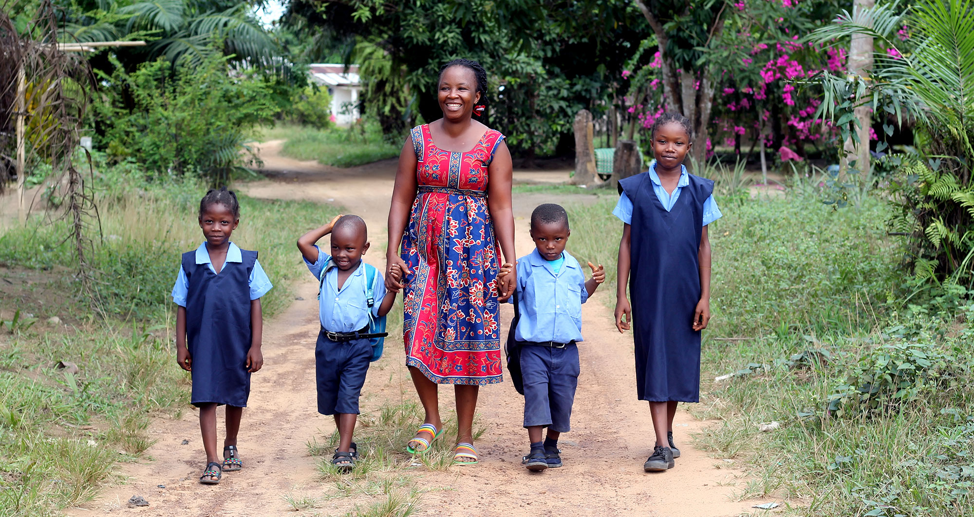 A Graduation participant with her children in Liberia