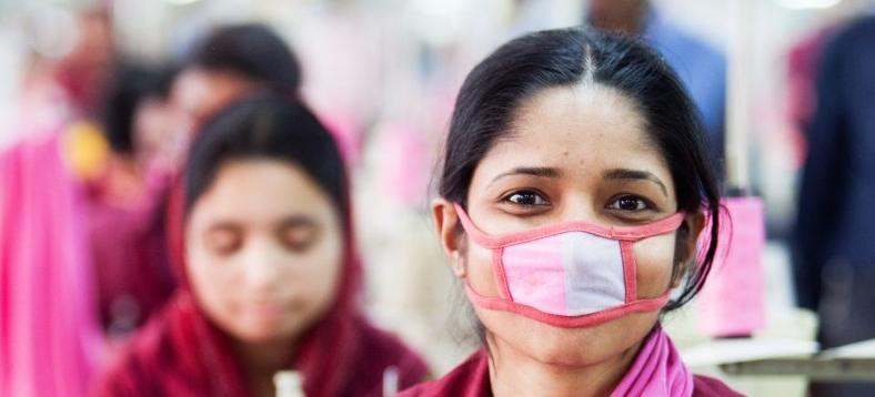 rohingya woman making a mask.