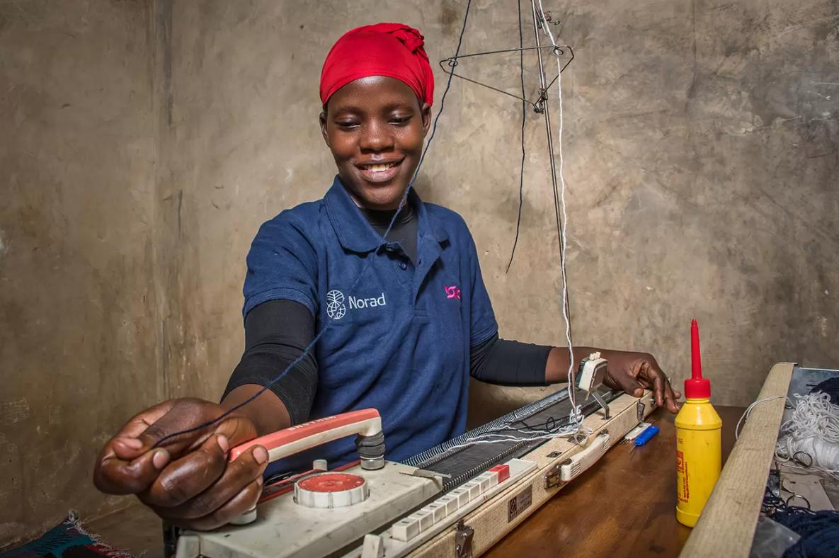 Hajara uses her knitting machine, which BRAC provided alongside skills training