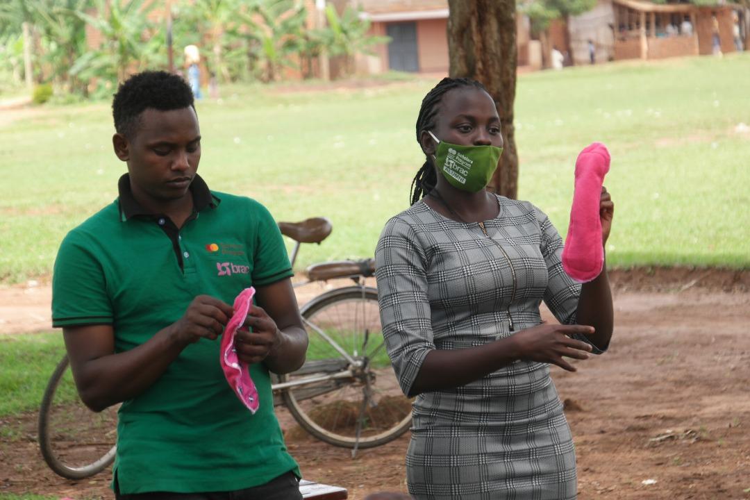 Cynthia distributes reusable sanitary pads to girls in Uganda.